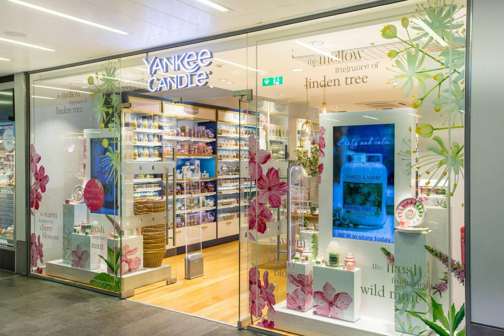 I used the creative concept and thematic created by the agency to artwork window decals for a new Yankee Candle concept store in Cheltenham